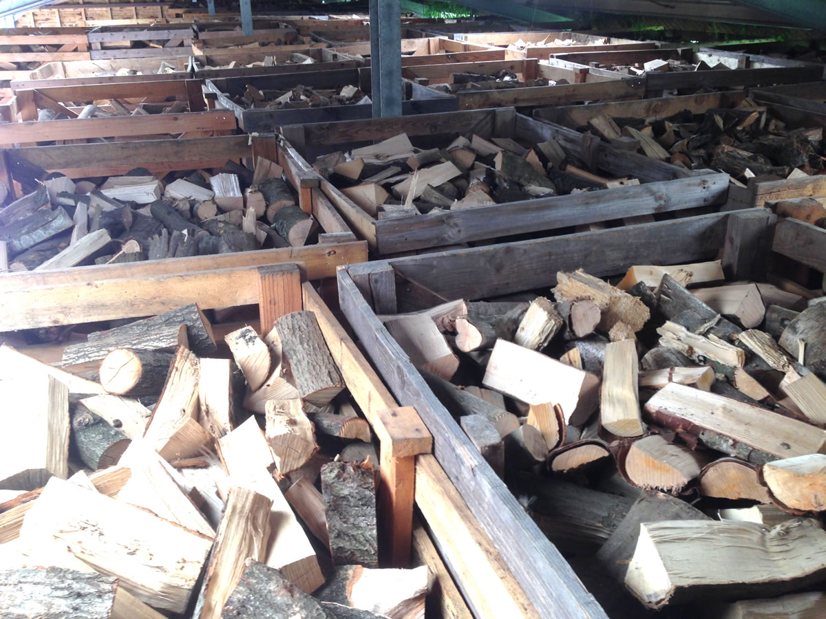 Barn stored logs after kiln drying
